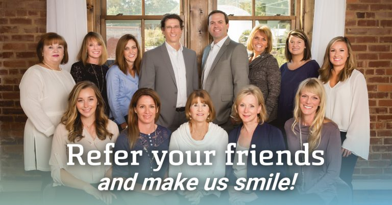 Refer your friends and make us smile! - with team photo in background