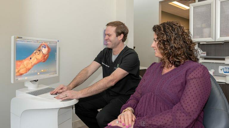 DOctor hooper explaining CEREC Scan to patient