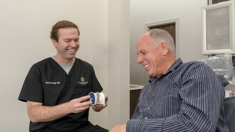Dr. Hooper demonstrating implants to patient